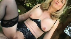 Naughty mature blonde in sexy black lingerie sucks and fucks a big cock POV style
