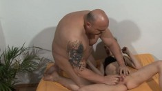 Slender brunette has a bald headed guy eating out and fucking her twat