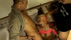 Freaky blonde slut takes a double barebacking in the bathroom
