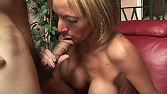 Freaky blonde slut with a fake tan gets slammed on a hairy cock