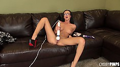 Hot brunette wearing nothing but glasses and heels sucks a dildo