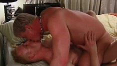 Attractive blonde gay lovers engage in hardcore anal sex on the bed