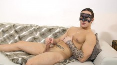 Masked hunk caresses his magnificent body and makes himself cum hard