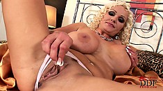 Blonde with a massive pair of titties rubs her pink pussy raw