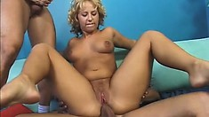 Hot blonde Georgia slides a dick in her mouth while another explores her anal hole