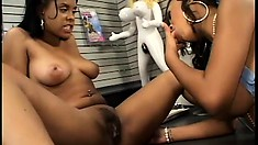 Hot black lesbians in an adult store indulge in pussy eating and a foot fetish