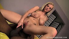 Beautiful blonde with a fabulous ass and puffy boobs is a sucker for black cock