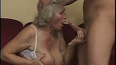 Cocksucking granny gets plowed by a young long-haired superstud