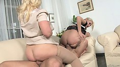 Blonde mom and daughter take care of his rod in both holes in threesome