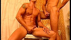 Athletic hunk gets his cumhole ripped in a steaming hot gay orgy