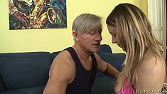 Skinny brunette in a jean skirt gives her ass to her old step dad