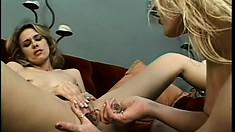 Amusing lesbian vixen with blonde hair messes the hot mature woman's cunt