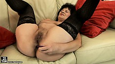 Frisky female in stockings gets her snatch and anus pierced by sex toys