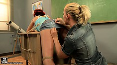 Kathia gets a busty redhead to play with and ties her to the desk
