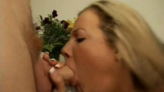 Blonde with a pierced belly button rubs her clit while giving head