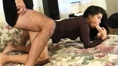 Inviting Asian brunette having fun with a big dildo and a hard shaft