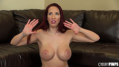 Busty redhead Kelly Divine is naked and showing her ass and twat