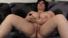 Chubby old mom with huge tits Anna lies on the couch and fucks a dildo