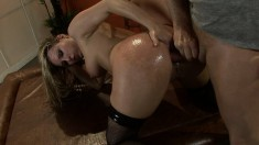 Busty Harmony Rose gets her ass oiled up for some dick penetration