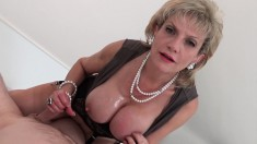 Naughty mature woman with big hooters gives a helping hand POV style