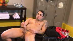 Gorgeous tattooed boy displays his fabulous body and pleases himself
