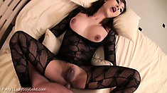 Cute Asian shemale in a sexy black bodysuit enjoys her time with a big cock on the bed