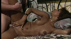 Sexy ebony babe with curly hair trades head and gets pumped hard