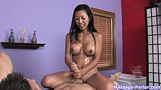 Jumping on top of him, the stacked hottie pleases his cock with her skilful hands